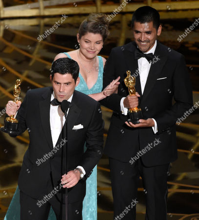 Pato Escala, from left, Antonia Herrera, and Gabriel Osorio accept the award for best animated short film for Bear Story at the Oscars, at the Dolby Theatre in Los Angeles