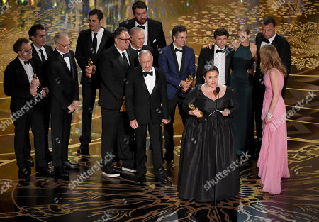 Nicole Rocklin, pictured at front, and cast and crew of Spotlight accept the award for best picture for Spotlight at the Oscars, at the Dolby Theatre in Los Angeles