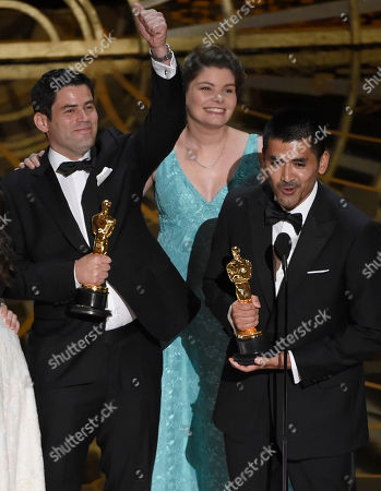 Antonia Herrera Oesterheld, Pato Escala, from left, Antonia Herrera, and Gabriel Osorio accept the award for best animated short film for Bear Story at the Oscars, at the Dolby Theatre in Los Angeles