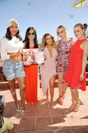 Stock Picture of Julissa Bermudez, Eva Kim, Adrienne Bailon, Kymberley and Alexis McClay seen at Adrienne Bailon celebrates her Cosmo for Latinas cover at the JustFab Beach House powered by Kia, in Malibu, Calif
