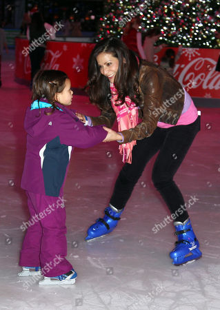 Actress Constance Marie, right, and her daughter, Luna Marie Katich, ice skate at AEG's Season of Giving celebrates Disney on Ice: Dare to Dream and Baby Buggy's Holiday Diaper Drive at L.A. LIVE, in Los Angeles