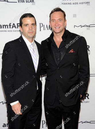 Television personality Clinton Kelly, right, and Damon Bayles arrive at the amfAR Inspiration gala at the New York Public Library on in New York