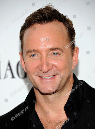 Television personality Clinton Kelly arrives at the amfAR Inspiration gala at the New York Public Library on in New York