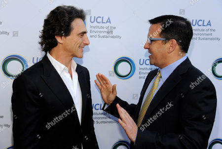 Honoree Lawrence Bender, left, mingles with Tony Pritzker at the UCLA Institute of the Environment and Sustainability's An Evening of Environmental Excellence on in Beverly Hills, Calif