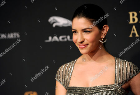 Jamie Gray Hyder arrives at the BAFTA Los Angeles Britannia Awards at the Beverly Hilton Hotel, in Beverly Hills, Calif