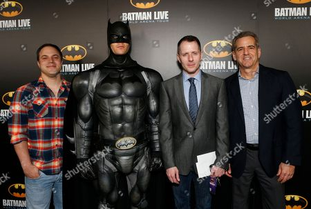 From left, Geoff Johns Chief Officer of DC Comics, Allan Heinberg, writer of Batman Live, and Brad Globe, President, Warner Bros. Consumer Products pose with Batman at the L.A. Batman Live Premiere, at STAPLES Center in Los Angeles