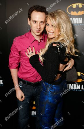 Stock Picture of Josh Sussman, left, and Tess Hunt arrive at the L.A. Batman Live Premiere, at STAPLES Center in Los Angeles