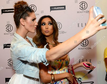 Cassandra Bankson, left, and Arika Sato arrive at BeautyCon Los Angeles 2014 in Partnership with Elle at LA Mart, in Los Angeles
