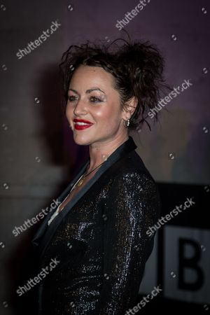 Actress Jamie Winstone poses for photographers upon arrival at the BBC Films 25th Anniversary Reception in London