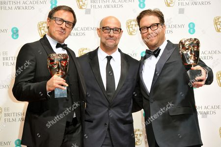 Stanley Tucci, centre with David O'Russell and Eric Warren Singer, winners of best original screenplay for American Hustle, pose for photographers in the winners room at the EE British Academy Film Awards held at the Royal Opera House, in London