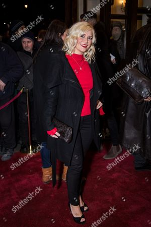 Susanne Shaw poses for photographers upon arrival at the world premiere of the play 'The End Of Longing' in London