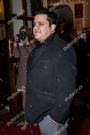 Nathan Amzi poses for photographers upon arrival at the world premiere of the play 'The End Of Longing' in London