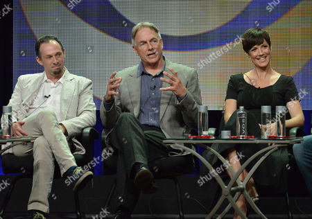 """From left, Executive producer Jeffrey Lieber, Executive producer Mark Harmon and actress Zoe McLellan speak on stage during the """"NCIS: New Orleans"""" panel at the CBS 2014 Summer TCA held at the Beverly Hilton Hotel, in Beverly Hills, Calif"""
