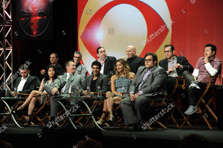 """Stock Photo of From left, front, Eddie Kaye Thomas, Jadyn Wong, Robert Patrick, Elyes Gabel, Katharine McPhee, and Ari Stidham; rear, Roberto Orci, Alex Kurtzman, Walter O'Brien, Nick Santora, Nicolas Wootton, and Justin Lin, appear on stage during the """"Scorpion"""" panel at the CBS 2014 Summer TCA held at the Beverly Hilton Hotel, in Beverly Hills, Calif"""