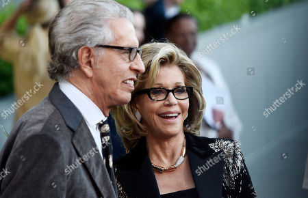 """Actress Jane Fonda, right, and record producer Richard Perry arrive at """"The Champions of Our Planet's Future"""" annual gala, in Beverly Hills, Calif"""