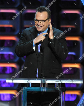 """Stock Picture of Tom Arnold appears on stage at the Comedy Central """"Roast of Roseanne"""" at the Hollywood Palladium, in Los Angeles"""