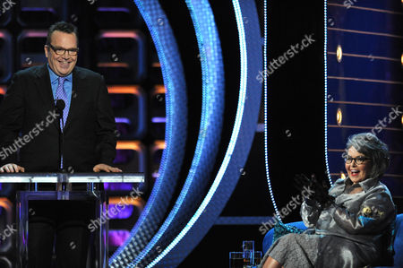 "Tom Arnold, left, and Roseanne Barr appear on stage at the Comedy Central ""Roast of Roseanne"" at the Hollywood Palladium, in Los Angeles"