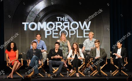 "Stock Photo of From top left, executive producers Greg Berlani, Julie Plec, Phil Klemmer and actors Aaron Yoo, Luke Mitchell, Peyton List, Robbie Amell, Mark Pellegrino and Madeline Mantock participate in the ""The Tomorrow People"" panel at the 2013 CW Summer TCA Press Tour at the Beverly Hilton Hotel on in Beverly Hills, Calif"