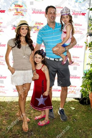 "Stock Image of Samantha Harris, Michael Hess and children Josselyn Sydney Hess, Hillary Madison Hess attend the Disney Junior's ""Pirate And Princess: Power Of Doing Good"" Tour event at Brookside Park, in Pasadena, Calif"