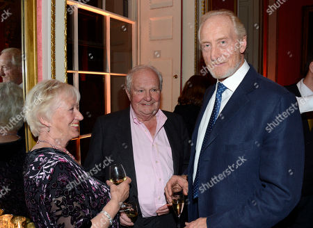 Stock Image of Sheila Rimmer, Shane Rimmer, Charles Dance poses at Everything or Nothing - The Untold Story of 007 After Party at Odeon West End on in London