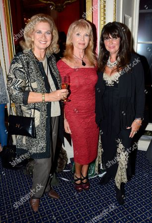 Valerie Leon, Sue Vanner, Caroline Munro poses at Everything or Nothing - The Untold Story of 007 After Party at Odeon West End on in London