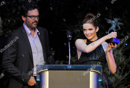 "Silas Weir Mitchell, left, and Bitsie Tulloch, cast members in the supernatural crime drama television series ""Grimm,"" accept their award at the Eyegore Awards at Universal Studios Hollywood, in Los Angeles"