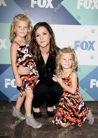 Stock Picture of Actors Shannon Woodward, center, and twins Baylie Cregut and Rylie Cregut arrive at the FOX Summer TCA All-Star Party, on in West Hollywood, Calif