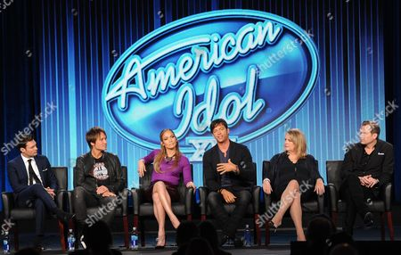"""From left, host Ryan Seacrest, judges Keith Urban, Jennifer Lopez and Harry Connick, Jr. and executive producers Trish Kinane and Per Blankens participate in FOX's """"American Idol XIII"""" panel at the FOX Winter TCA Press Tour, on at the Langham Huntington, in Pasadena, Calif"""