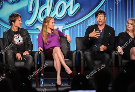 """From left, judges Keith Urban, Jennifer Lopez and Harry Connick, Jr. and executive producer Trish Kinane participate in FOX's """"American Idol XIII"""" panel at the FOX Winter TCA Press Tour, on at the Langham Huntington, in Pasadena, Calif"""