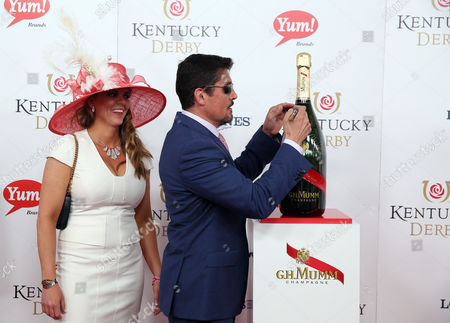 Stephen Amell and wife Cassandra Jean attends the G.H. Mumm Champagne event at the Kentucky Derby, in Louisville, Ky