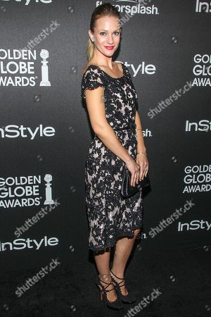 Actress A. J. Cook arrives at the Hollywood Foreign Press Association's celebration of the 2014 Golden Globe Award Season at the Fig & Olive on in West Hollywood, Calif