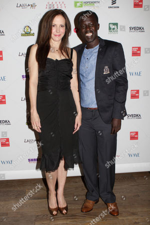 Mary Louise Parker and Hope North founder, Okello Sam attend the Hope North Gala, on Wednesday, September, 18, 2013 in New York