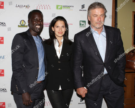 From left, Hope North founder, Okello Sam, Hilaria Baldwin and Alec Baldwin attend the Hope North Gala, on Wednesday, September, 18, 2013, in New York