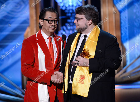 George Cheung, left, presents Guillermo del Toro with the award for best global director on stage at the Huading Film Awards at the Ricardo Montalban Theater, in Hollywood, Calif