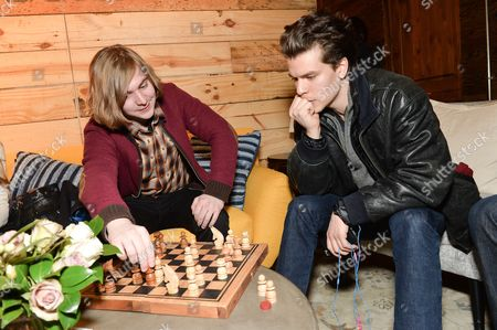 Stock Picture of Actors Danny Flaherty, left, and Gus Halper, take a chess break at the Indiewire Photo Studio at Chase Sapphire on Main during the 2016 Sundance Film Festival on in Park City, Utah