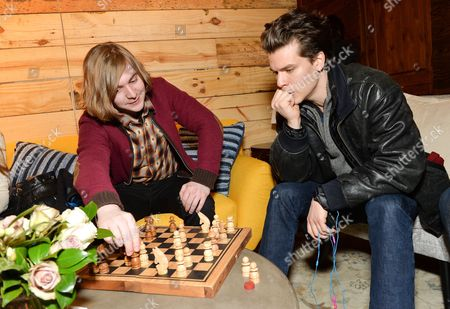 Stock Image of Actors Danny Flaherty, left, and Gus Halper, take a chess break at the Indiewire Photo Studio at Chase Sapphire on Main during the 2016 Sundance Film Festival on in Park City, Utah