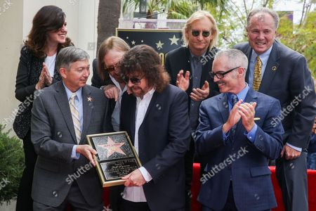 Stock Image of Maureen Schultz, from left, President and CEO of the Hollywood Chamber of Commerce Leron Gubler, Tom Petty, Jeff Lynne, Joe Walsh and Los Angeles City Councilmembers Mitch O'Farrell and Tom LaBonge attend a ceremony honoring Jeff Lynne with a star on The Hollywood Walk of Fame, in Los Angeles