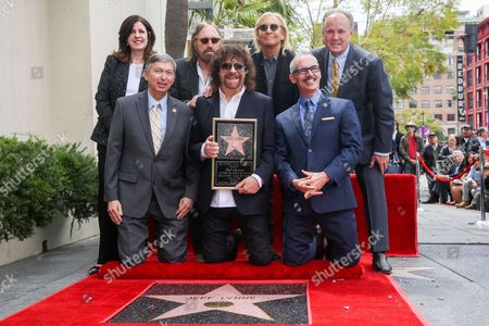 Stock Photo of Maureen Schultz, from left, President and CEO of the Hollywood Chamber of Commerce Leron Gubler, Tom Petty, Jeff Lynne, Joe Walsh and Los Angeles City Councilmembers Mitch O'Farrell and Tom LaBonge attend a ceremony honoring Jeff Lynne with a star on The Hollywood Walk of Fame, in Los Angeles