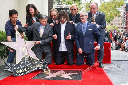 Stock Picture of Maureen Schultz, from left, President and CEO of the Hollywood Chamber of Commerce Leron Gubler, Tom Petty, Jeff Lynne, Joe Walsh and Los Angeles City Councilmembers Mitch O'Farrell and Tom LaBonge attend a ceremony honoring Jeff Lynne with a star on The Hollywood Walk of Fame, in Los Angeles