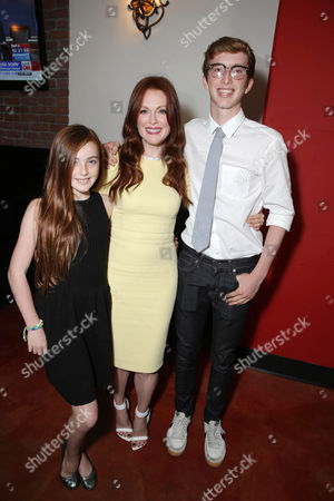 EXCLUSIVE CONTENT - PREMIUM RATES APPLY Liv Freundlich, Julianne Moore and Caleb Freundlich at Julianne Moore's Star Ceremony on the Hollywood Walk of Fame, on Thursday, Oct, 3, 2013 in Hollywood