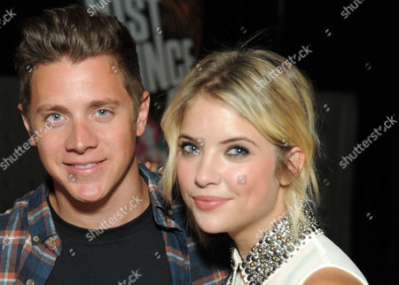 """The Bachelorette"""" winner Jef Holm, left, party host Ashley Benson attend the Just Dance 4 launch party on in Los Angeles.Â"""