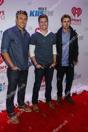 Stock Picture of From left, Zack Kalter, Drew Kenney and Robert Graham arrive at KIIS 102.7 Jingle Ball held at Staples Center, on Friday, December, 6, 2013 in Los Angeles, CA