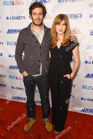 "Adam Brody, left, and Lisa Joyce arrive at a premiere of ""Billy & Billie"" at The Lot, in West Hollywood, Calif"