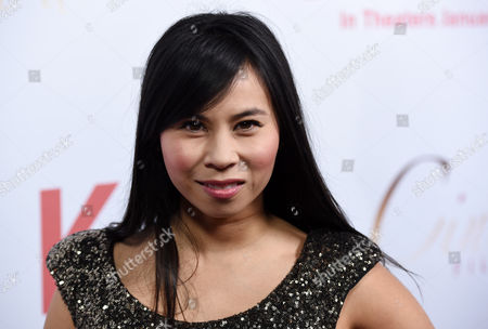 """Stock Image of Camille Mana, a cast member in """"Cake,"""" poses at the premiere of the film at Arclight Cinemas, in Los Angeles"""