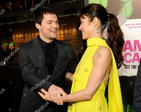 "Danila Kozlovsky, left, a cast member in ""Vampire Academy,"" greets fellow cast member Olga Kurylenko at the premiere of the film, in Los Angeles"
