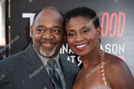 """Gregg Daniel, left, and Adina Porter arrive at the Los Angeles premiere of the 7th and final season of """"True Blood"""" at the TCL Chinese Theatre on"""