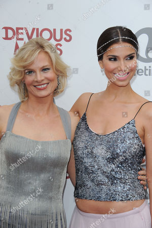 """Roselyn Sanchez, at right, and Melinda Page Hamilton attend the premiere party for """"Devious Maids"""" at the Bel-Air Bay Club on in Los Angeles"""