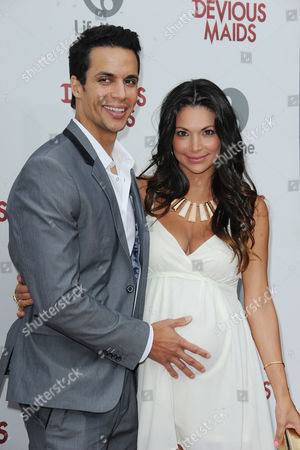 "Matt Cedeno, at left, and Erica Franco attends the premiere party for ""Devious Maids"" at the Bel-Air Bay Club on in Los Angeles"