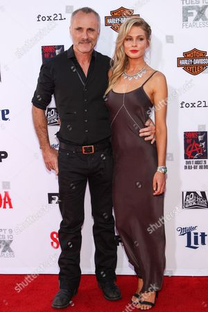 """Timothy V Murphy, left, and Caitlin Manley attend the LA Premiere Screening of """"Sons Of Anarchy"""" at at TCL Chinese Theatre, in Los Angeles"""