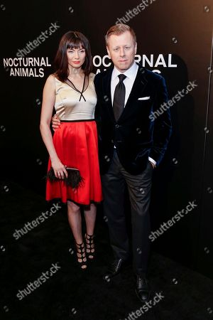 "Abel Korzeniowski, right, and Mina Korzeniowska arrive at the LA Special Screening of ""Nocturnal Animals"" at the Hammer Museum, in Los Angeles"